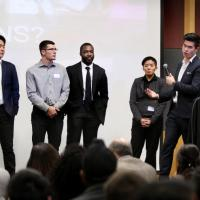 Capstone team member Jason Pan taking questions from the audience about Swap