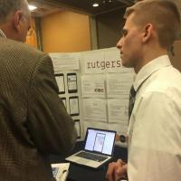ITI 210 student Sebastian Osiecki discusses his project with a Showcase guest