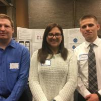 Showcase students T. J. White, Alexandra Faltyn, Sebastian Osiecki with their project