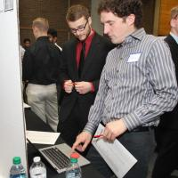 Randall Newman shows Matt Batko how the RU Hungry app works