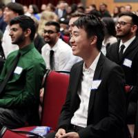 ITI 210 students Kathy Lei, Binay Patel, Kunal Patel, Pakar Patel, and Jian Song enjoying the Capstone presentation