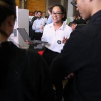 "Anchalee Pagsanjan demos the ""What to Wear"" app for fellow students"