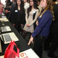 Kajal Patel and Lauren Richardson present their project XploreD to Winnie Cho