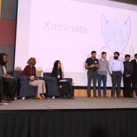 Xaminate on stage with judges